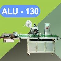Máy dán nhãn túi tự động ALU 130.jpg